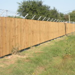 6 ft. High Security Treated Privacy Fence with Barbed Wire